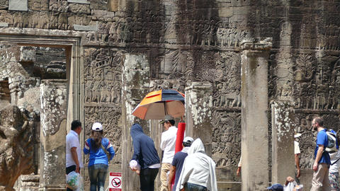 Tourists walking at the Bayon Khmer temple Footage