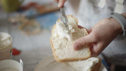 Female hands making a cheese sandwich Footage