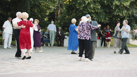 Elderly people dancing in the Park Footage