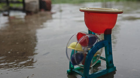 Toy water mill in the rain Footage