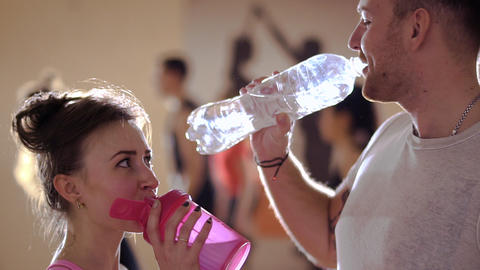 Young dancers drinks water after dance training in the gym Live Action