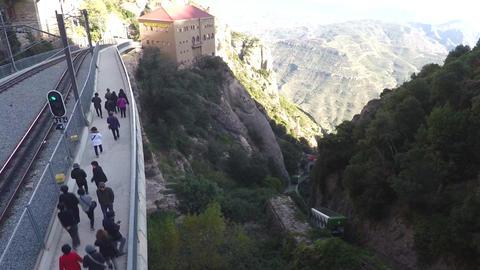 Tourists Walking On Mountain Path Near Rails Image