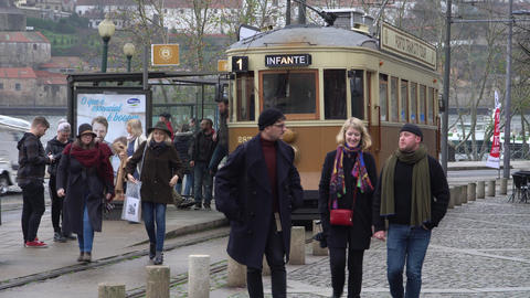 Porto, Portugal, circa 2018: Old tram passing by in the old town of Porto Footage