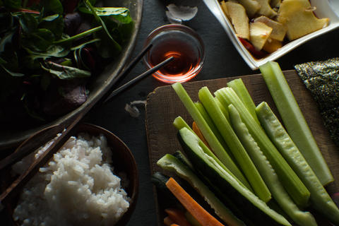 Chopsticks, rice and ingredients for making sushi are a top view. Asian cuisine Photo