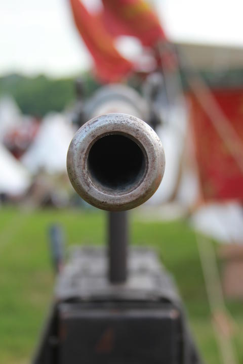 Muzzle of the old cannon フォト