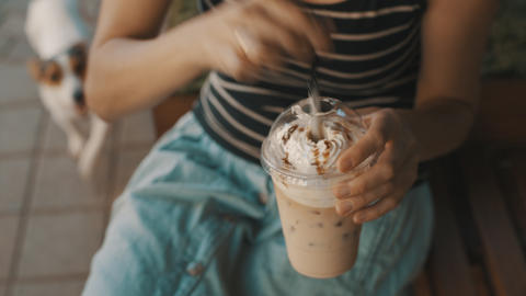 Woman drinking cold coffee with whipped cream Footage
