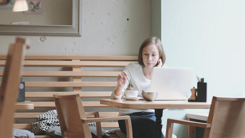 Young woman drinking coffee and working Footage