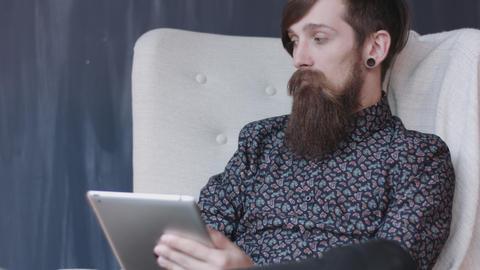 Hipster using digital tablet Footage