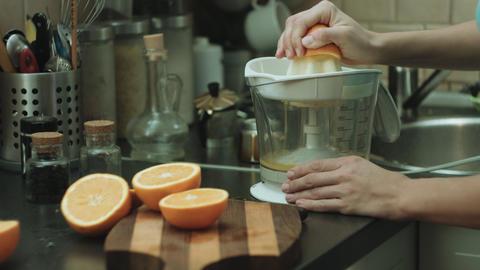 Woman makes orange fresh Live Action
