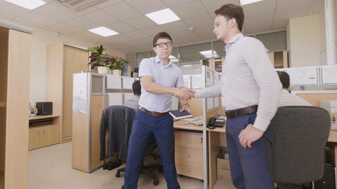Colleagues Shake Hands and Engineers at Computers Footage