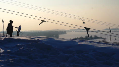 landscape winter slides ski resort,ski lift,going down downhill snowboarders and Footage
