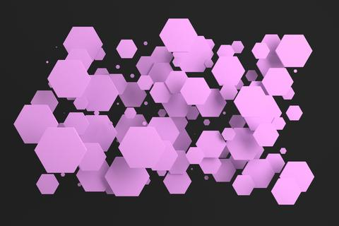 Violet hexagons of random size on black background Photo