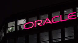 Munich / Germany - February 17 2018 : The Oracle Logo is shining in the night Footage