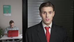 Young successful man in a suit shows an emotion of doubt, uncertain, portrait Footage