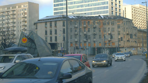 WARSAW, POLAND - MARCH 1, 2018. City street traffic and metro station entrance Footage