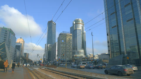 WARSAW, POLAND - MARCH 1, 2018. City street traffic and office skyscrapers in Footage