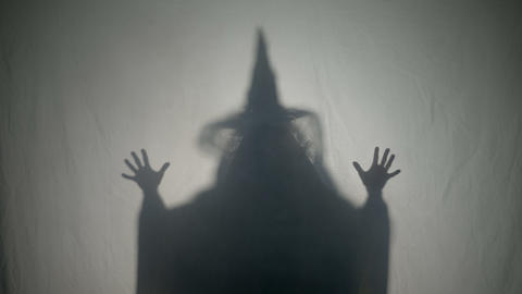 Halloween malefic witch laughing and putting an evil spell on people on Footage