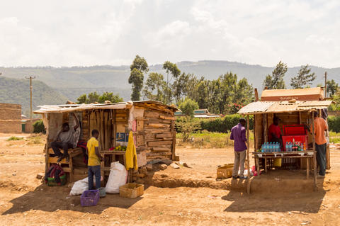 Two wooden stalls on the roadside in Kenya's rift valley Photo