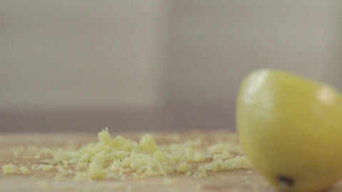 Lemon's filings falling on cutting board Live Action