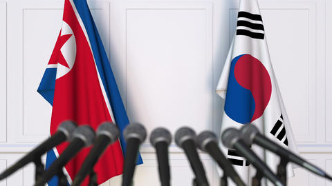 Flags of North Korea and Korea at international meeting or negotiations press 영상물