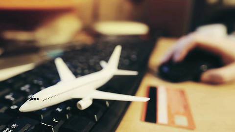 A man book airline tickets on the airline's website. Defocused person buys Live Action