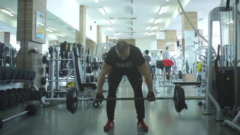 Muscular Man Lifting In Gym Footage