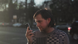 Man Using Cell Telephone While Standing On Street stock footage