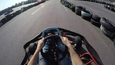 Man drives go kart on track, Karting filmed from the driver's view, man holds th Footage