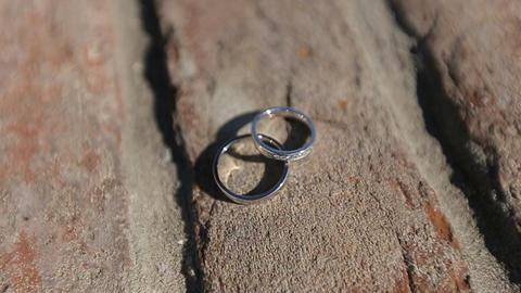 Wedding rings on the brick Footage