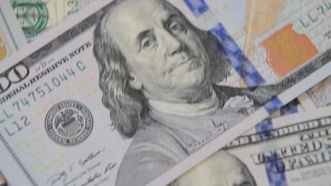 close up dolly shot of scattered American paper money bills. Cash money backgrou Live Action