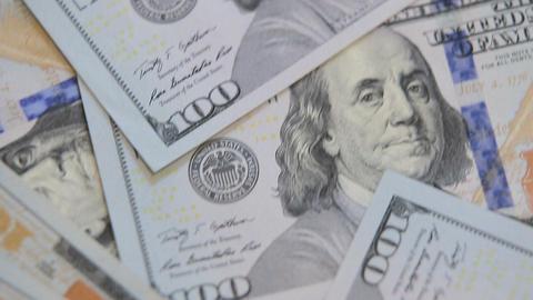 close up dolly shot of scattered American paper money bills. Cash money backgrou Footage