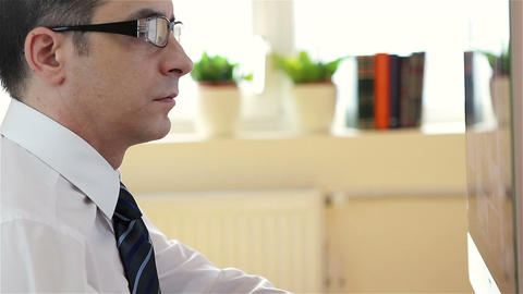 Businessman with glasses working at the computer Footage