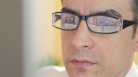 Businessman with glasses working on computer Footage