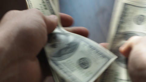 Man's hands counting hundred dollar bills Footage