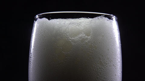 Close-up of beer foam on a black background Footage