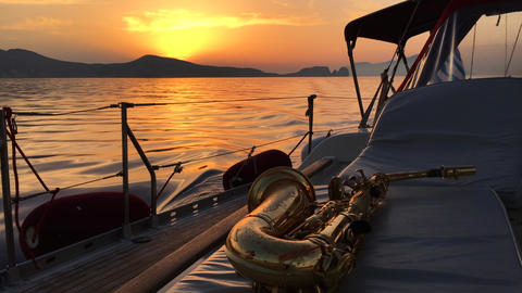 Saxophone sunset at yacht Footage