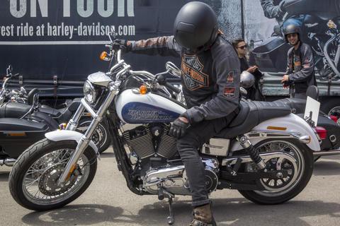 Happy driver riding Harley Davidson Photo