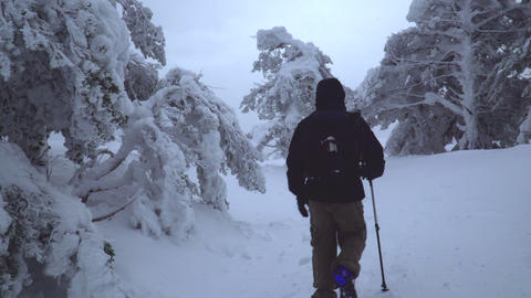 Tracking shot of mountaneer into a beautiful snowy mountain Footage