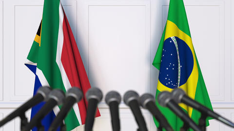 Flags of South Africa and Brazil at international meeting or negotiations press Footage