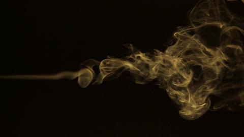 Beautiful line turns into a puffs of smoke.Yellow smoke Footage