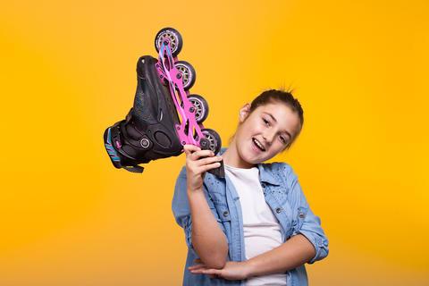 Happy kid holding a roller in hads Fotografía