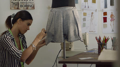 Young female fashion designer working on mannequin Footage