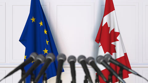 Flags of the European Union and Canada at international press conference Live Action
