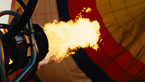 Gas flame to fill air balloon with hot air Footage