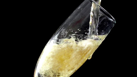Champagne pouring into glass in slow motion ,200 fps Live Action