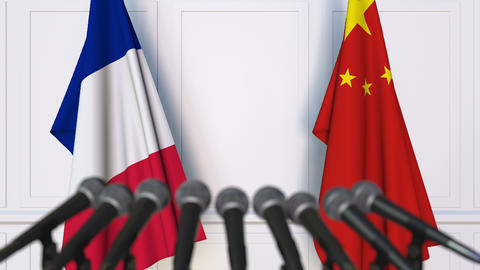 Flags of France and China at international press conference Footage