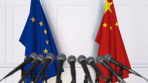 Flags of the European Union and China at international press conference Live Action