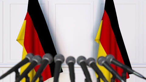 German official press conference featuring flags of Germany Footage