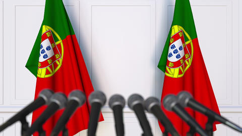 Portuguese official press conference. Flags of Portugal and microphones Footage