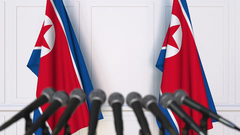 North Korean official press conference. Flags of North Korea and microphones Live Action